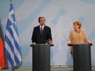 Φωτογραφία για Μέρκελ: Θέλω η Ελλάδα να μείνει μέλος της Ευρωζώνης